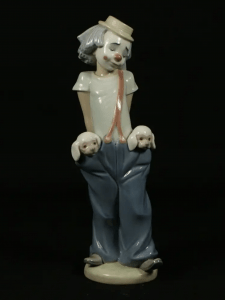 Porcelain clown with puppies in pockets, possibly Lladro or Nao appraisal