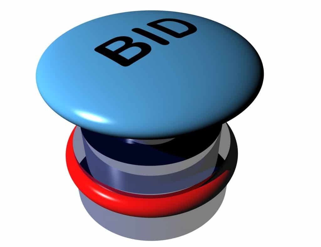 "Large button with ""bid"" written on top"